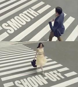 オシャレな服を着て横断歩道を渡る男女