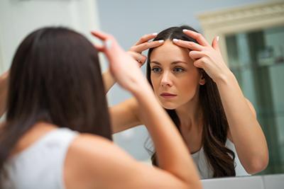 Worried,Woman,Is,Looking,At,Her,Wrinkles,In,The,Bathroom.