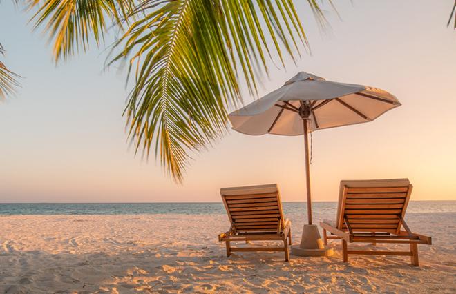 Beautiful,Beach.,Chairs,On,The,Sandy,Beach,Near,The,Sea.