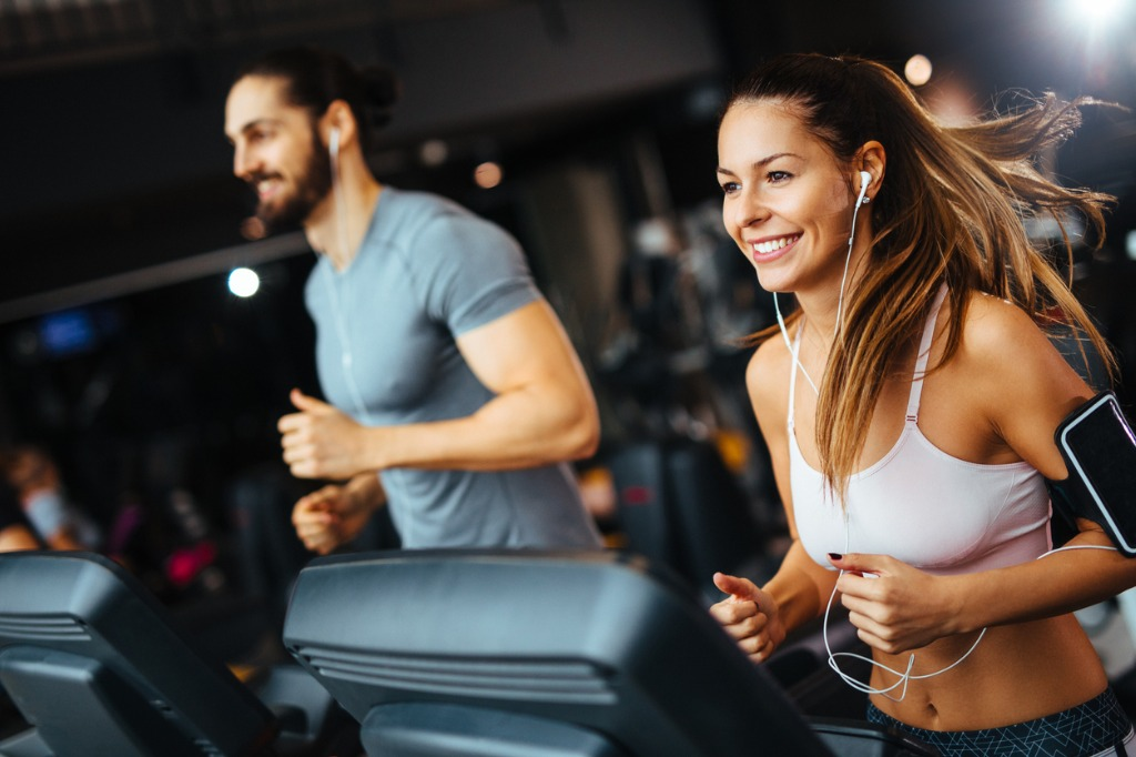 sporty-people-running-on-treadmills-in-a-health-club-picture-id1092140606